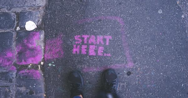 Chalk message on sidewalk that says start here.